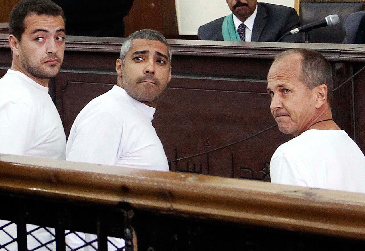จากซ้าย นายบาเฮอร์ โมฮัมเหม็ด, โมฮัมเหม็ด ฟาห์มี และปีเตอร์ เกรสเต (ภาพ: AP Photo)