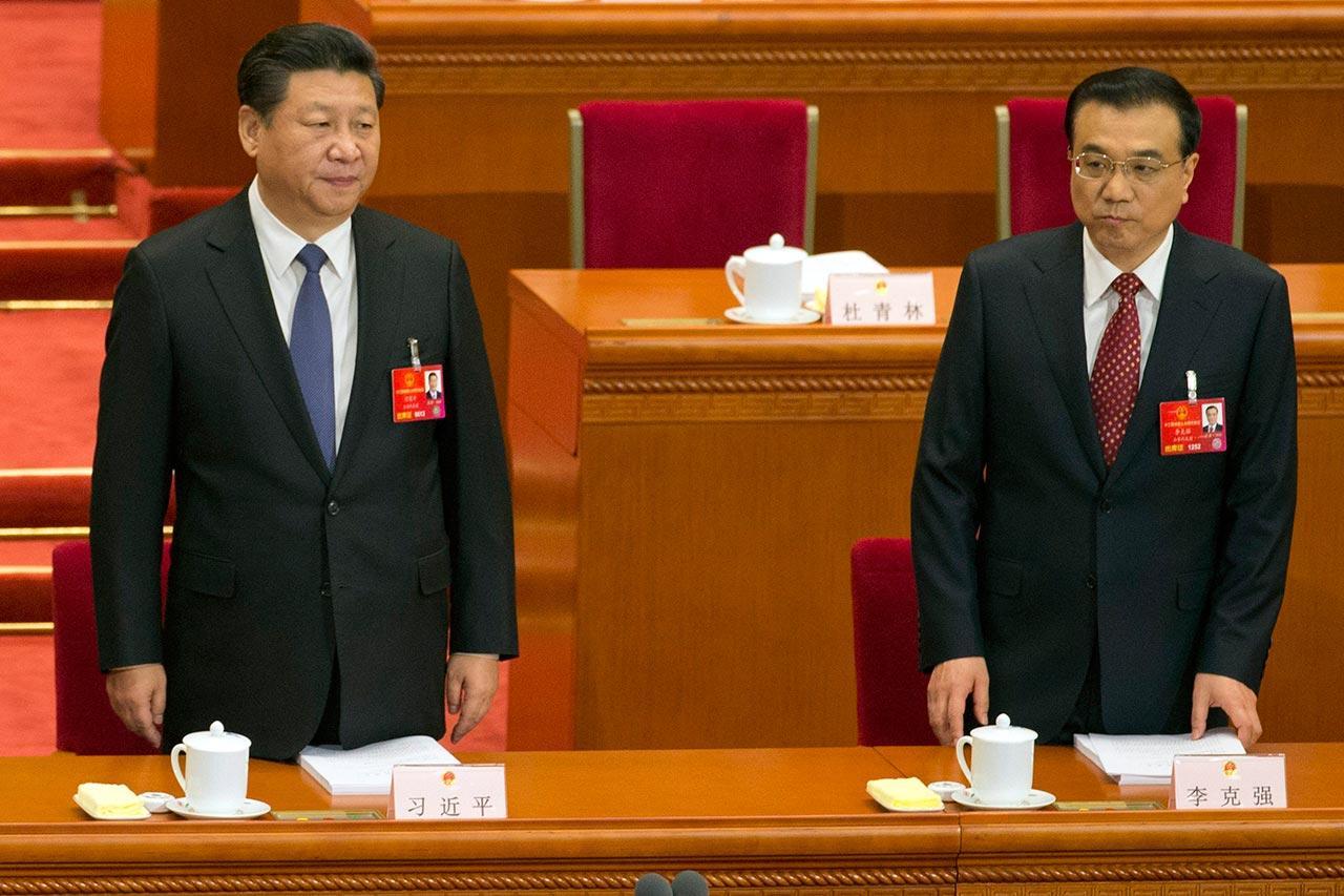 ประธานาธิบดี สี จิ้นผิง และนายกรัฐมนตรีหลี่ เค่อเฉียง (ภาพ: AP)