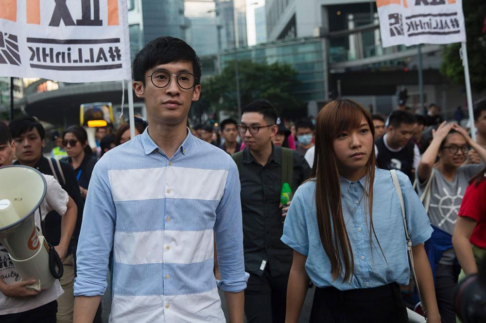 นายบักจิโอ เหลียง   และน.ส.เหยา ไหว ชิง  2 นักเคลื่อนไหวเรียกร้องประชาธิปไตยในฮ่องกง