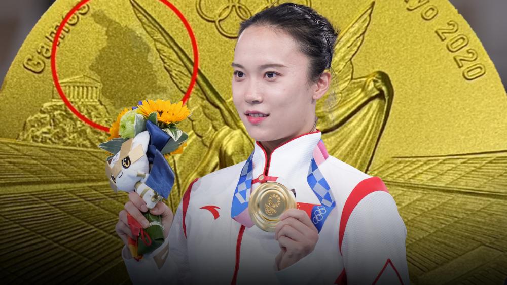 นึกว่าได้ของปลอม นักยิมนาสติกสาวจีนสุดงง เจอทองลอกในเหรียญโอลิมปิก